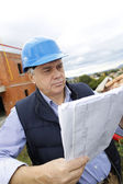 Construction manager checking building project on site — Stock Photo