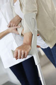 Closeup of old woman's hands leaning on crutches — Stock Photo