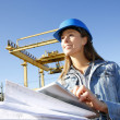 Woman engineer on building site using tablet — Foto de Stock
