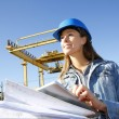 Woman engineer on building site using tablet — Stockfoto