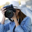 Woman photographer taking professional pictures — Stock Photo