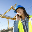 Construction manager talking on mobile phone — Stock Photo #26971579