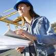 Woman engineer on building site using tablet — Stock Photo #26971589