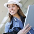 Smiling photographer using digital tablet — Stock Photo