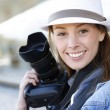 Beautiful woman photographer holding photo camera — Stock Photo #26971615