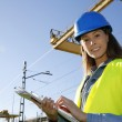 Site manager using electronic tablet — Stock Photo #26971617