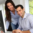 Young office workers in front of desktop computer — Stock Photo #26975303