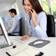 Smiling office worker talking on mobile phone — Stock Photo #26975305