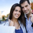 Smiling couple doing Christmas shopping — Stock Photo #26975479