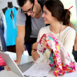 Fashion designers working on creation in workshop — Stok fotoğraf