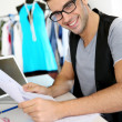 Smiling fashion designer in workshop — Stock Photo