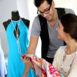 Stock Photo: Fashion designers working on creation in workshop