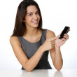 Beautiful girl showing smartphone screen to camera — Stock Photo #26975759