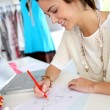 Stock Photo: Fashion designer working on creation