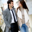 Trendy couple of lovers walking in the street — Stock Photo