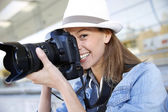 Photographer capturing photo with professional camera — Stock Photo