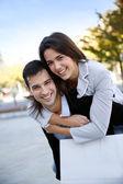 Young couple having fun doing shopping — Stock Photo