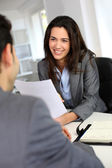 Businesswoman giving job interview — Stock Photo