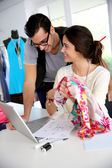 Fashion designers working on creation in workshop — Stock Photo