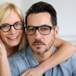 Middle-aged couple wearing eyeglasses — Stock Photo #27877177