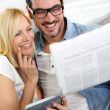 Couple at home reading news — Stock Photo #27877219