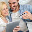 Couple shopping on internet with credit card — Stock Photo #27877243