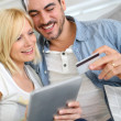 Couple shopping on internet with credit card — Stock Photo #27877257