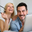 Stock Photo: Cheerful couple websurfing on internet with tablet