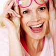 Beautiful young woman wearing pink glasses — Stock Photo