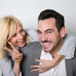 Cheerful trendy couple having fun — Stock Photo #27877617