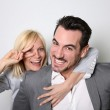 Cheerful trendy couple having fun — Stock Photo #27877625