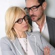 Trendy couple with eyeglasses on white background — Stock Photo