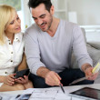 Couple looking at paint colors for new home — Stock Photo #27877779