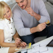 Couple looking at paint colors for new home — Stock Photo