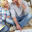 Couple looking at new home construction plan — Stock Photo #27877927