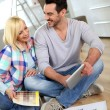 Couple looking at new home construction plan — Stock Photo #27877931