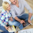 图库照片: Couple looking at new home construction plan