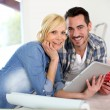 Stock Photo: Middle-aged couple choosing wall colours for new home
