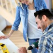 Couple installing furniture in new house — Stok fotoğraf
