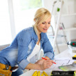 Stock Photo: Womworking on home improvement planning