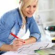 Stock Photo: Woman working on home improvement planning