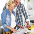 Couple designing home interior project — Stock Photo #27878107