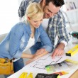 Couple designing home interior project — Stock Photo #27878109