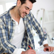 Man designing new house interior — Stock Photo