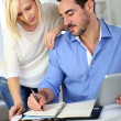 Middle-aged couple working from home — Stock Photo