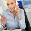 Businesswoman on the phone writing on agenda — Stock Photo