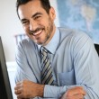 Cheerful businessman in office — Stock Photo