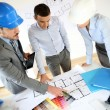 Team of architects presenting construction project — Stock Photo #27879023