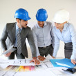 Team of architects presenting construction project — Stock Photo