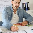 Stock Photo: Portrait of architect working on project